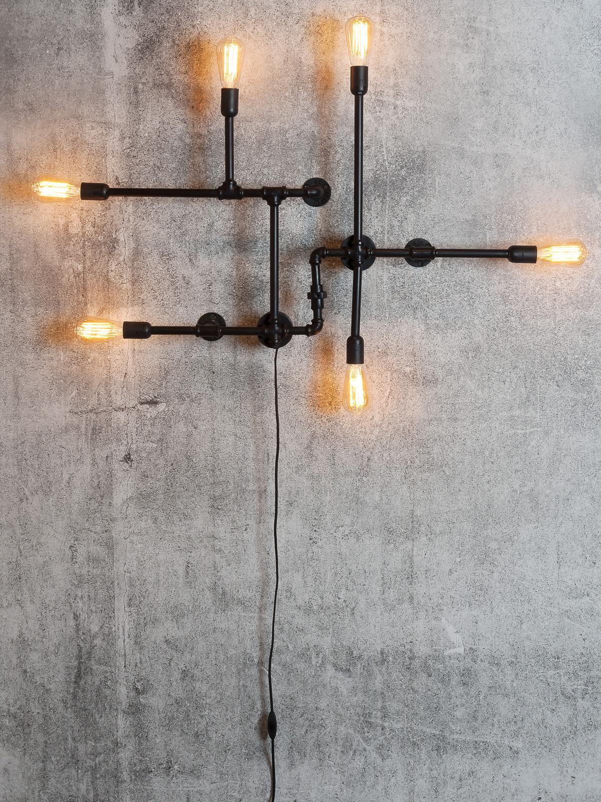 wasserrohr wandleuchte als blickfang eine lampe aus rohren casa lumi. Black Bedroom Furniture Sets. Home Design Ideas