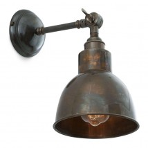 Nostalgic brass wall light with adjustable brass shade
